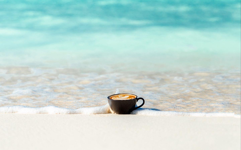 1440x900 Wallpaper cup, ocean, sand, coast, minimalism