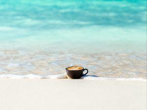 Preview wallpaper cup, ocean, sand, coast, minimalism
