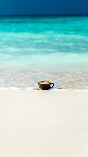360x640 Wallpaper cup, ocean, sand, coast, minimalism