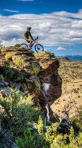 Preview wallpaper cyclist, bike, rock, cliff, nature