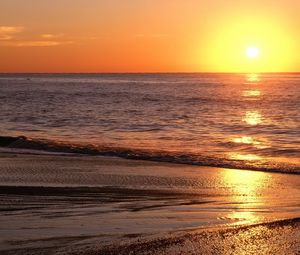 Preview wallpaper decline, sea, sand, horizon, evening, beach, light, patches of light, waves, orange, ripples, calm
