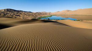 Preview wallpaper desert, sand, patterns, lines, oasis, lake, coast, vegetation