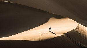 Preview wallpaper desert, sand, silhouette, dunes, lonely, wanderer
