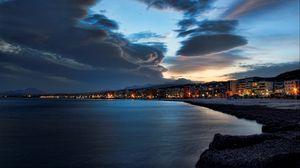 Preview wallpaper evening, beach, city, sky, sea