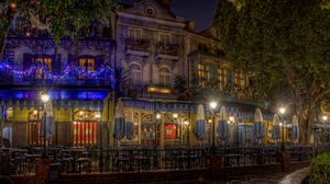 Preview wallpaper evening, city, street, christmas ornaments, garlands, lights, houses, buildings, cafes