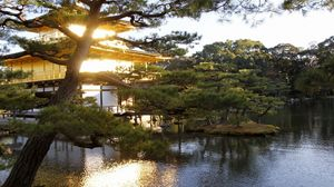 Preview wallpaper evening, japan, mansion, water, garden, trees