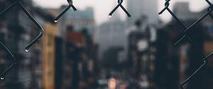 Preview wallpaper fence, grid, hole, rain, city, blur