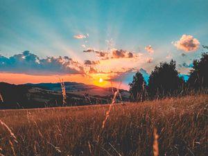 Preview wallpaper field, sunset, grass, sky, clouds