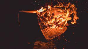 Preview wallpaper fire, sparks, newspaper, dark