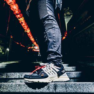 Preview wallpaper foot, sneaker, ladder, jeans