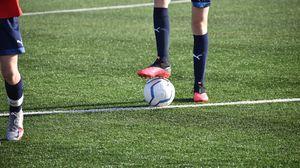 Preview wallpaper football, footballer, legs, ball, field