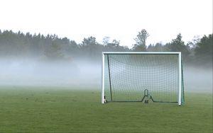 Preview wallpaper football goal, field, football, fog, trees, haze