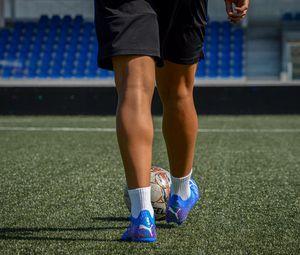 Preview wallpaper footballer, legs, ball, field, football, sport