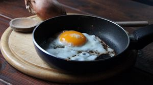 Preview wallpaper fried eggs, onion, pan, cutting board