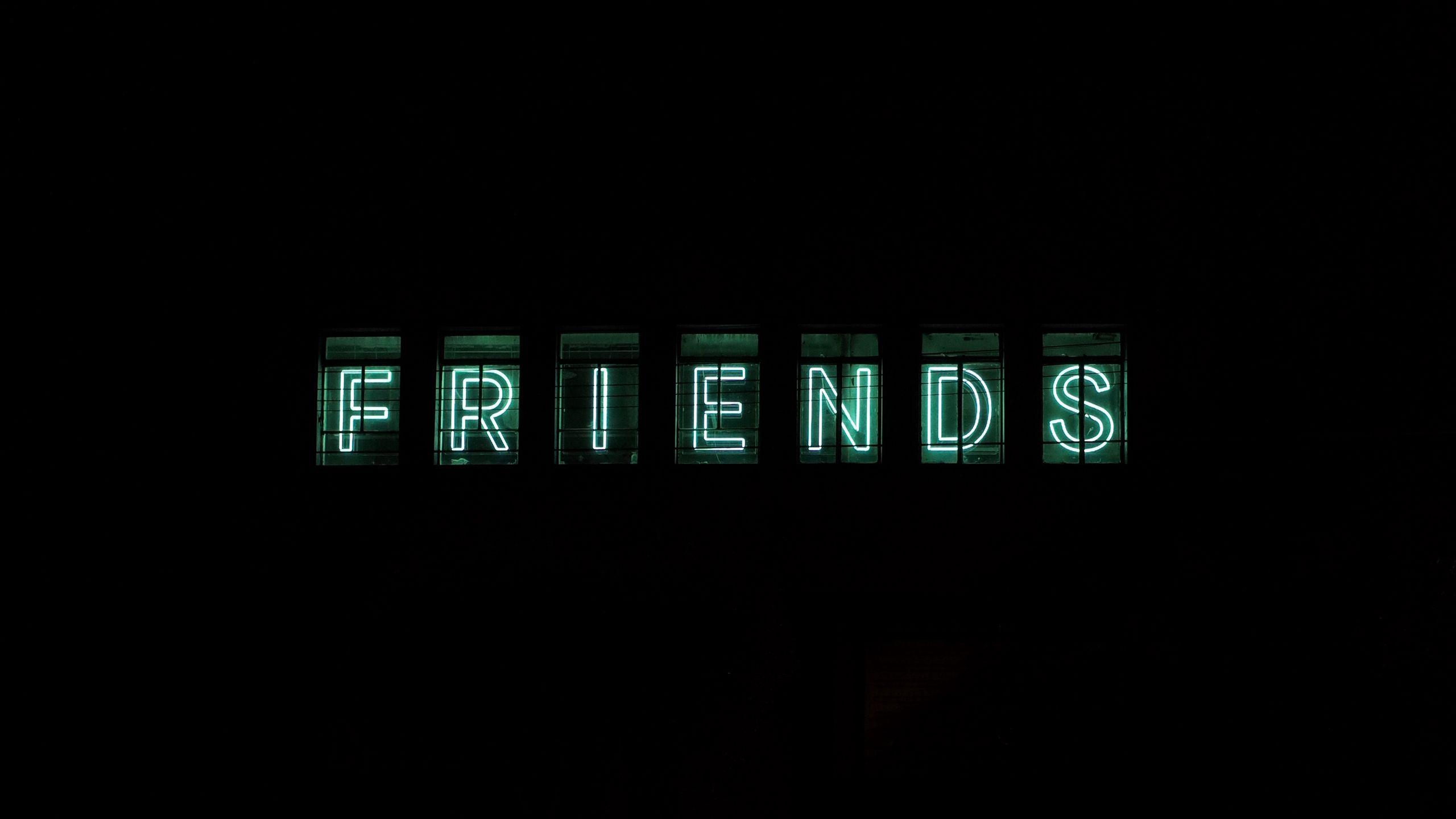 2560x1440 Wallpaper friends, inscription, neon, backlight, dark, letters