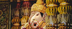 Preview wallpaper ganesha, deity, god, religion, statuette, columns, golden