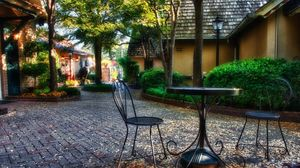 Preview wallpaper garden, plants, sculptures, houses, table, chairs, autumn, leaves