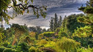 Preview wallpaper garden, sky, clouds, bridge, vegetation, tree nursery, leaves, arbor, green