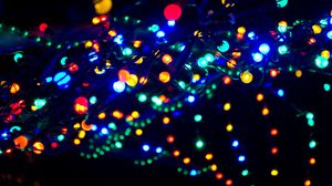 Preview wallpaper garland, glare, light, blur, colorful
