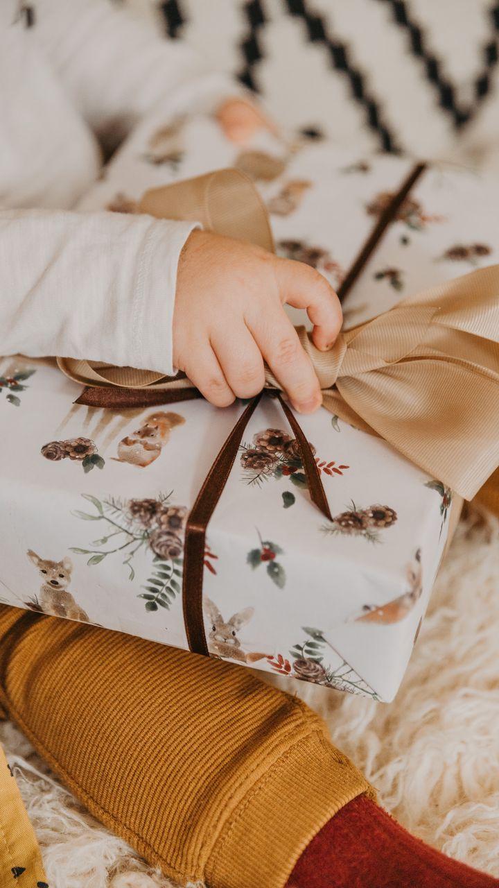 720x1280 Wallpaper gift, box, bow, hand, child