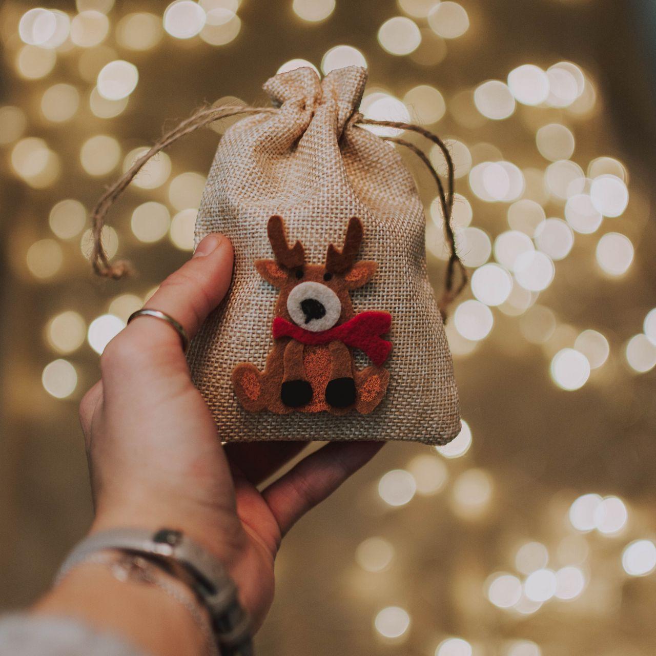 1280x1280 Wallpaper gift, new year, christmas, deer, hand