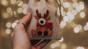 Preview wallpaper gift, new year, christmas, deer, hand