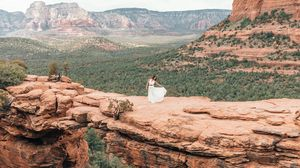Preview wallpaper girl, dress, canyon, cliff, valley