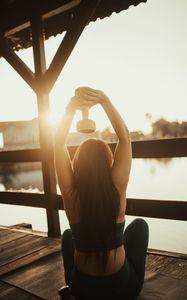 Preview wallpaper girl, dumbbell, fitness, pier, sunset
