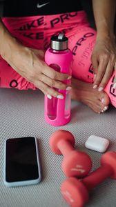 Preview wallpaper girl, bottle, dumbbells, fitness, sport, pink