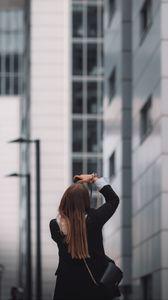 Preview wallpaper girl, photographer, bag, shooting, building