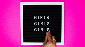 Preview wallpaper girls, words, letters, hand, tablet