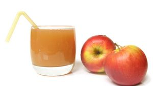 Preview wallpaper glass, juice, apples, straw, white background