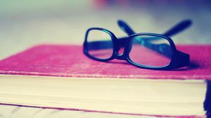 Preview wallpaper glasses, book, table, cover