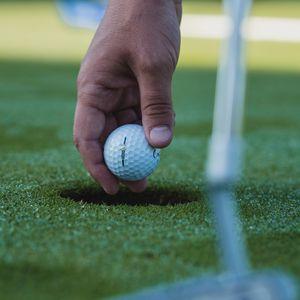Preview wallpaper golf, ball, hand, grass, sport