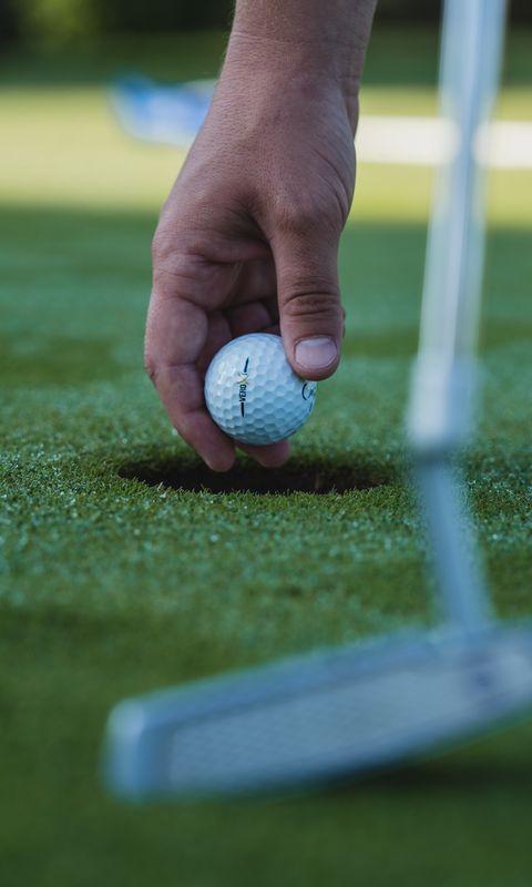 480x800 Wallpaper golf, ball, hand, grass, sport