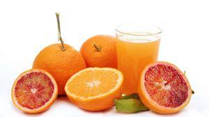Preview wallpaper grapefruit, orange, juice, glass, white background