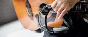 Preview wallpaper guitar, guitarist, headphones, music