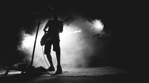 Preview wallpaper guitarist, musician, concert, microphone, performance, smoke, black and white