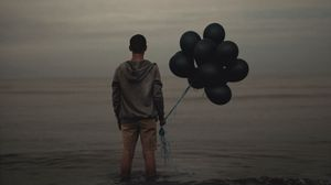 Preview wallpaper guy, balloons, sea, loneliness