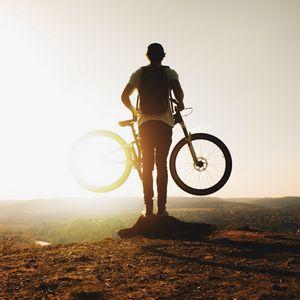 Preview wallpaper guy, bike, sun, mountains, active