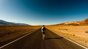 Preview wallpaper guy, road, way, back, loneliness, emptiness