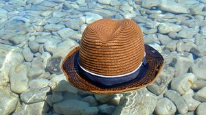 Preview wallpaper hat, water, stones, coast