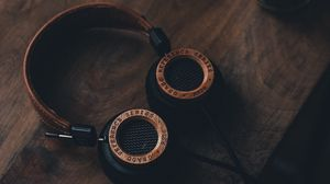 Preview wallpaper headphones, table, sound, wooden