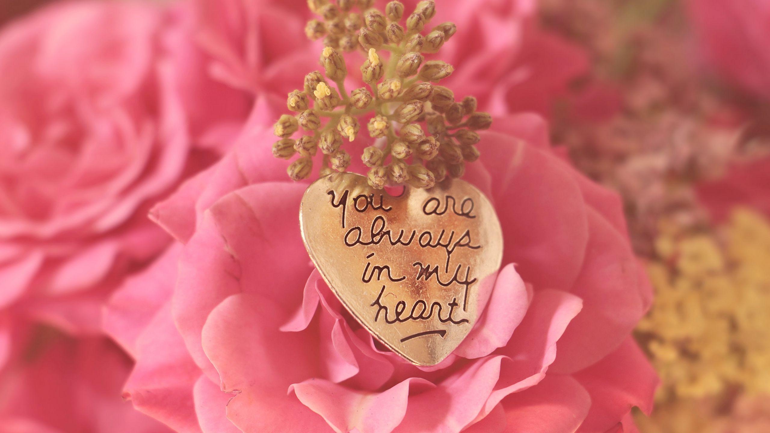 2560x1440 Wallpaper heart, pendant, love, inscription, confession, romance
