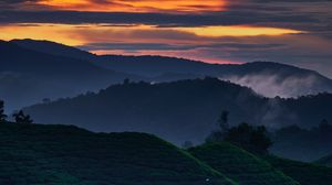 Preview wallpaper hills, distance, sunset, trees, sky