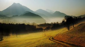 Preview wallpaper hills, mountains, road, country, morning, fog, relief