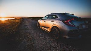 Preview wallpaper honda, car, gray, track, sunset