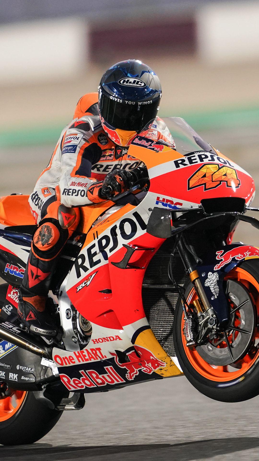 1080x1920 Wallpaper honda, motorcycle, motorcyclist, helmet, speed, track, orange