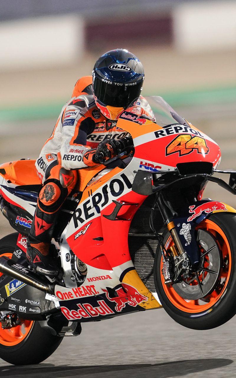 800x1280 Wallpaper honda, motorcycle, motorcyclist, helmet, speed, track, orange