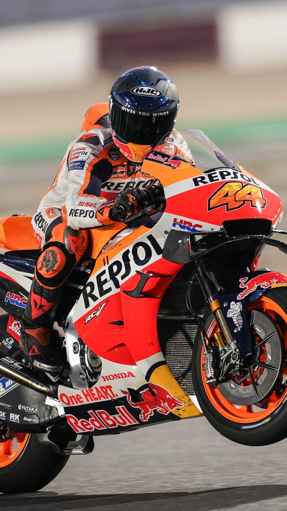 938x1668 Wallpaper honda, motorcycle, motorcyclist, helmet, speed, track, orange